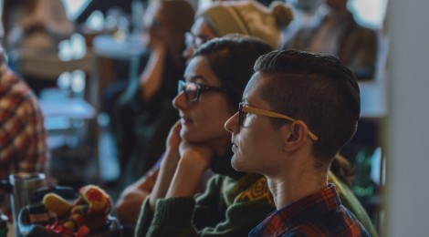 two forum participants watching a presentation