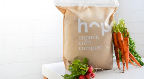 a bag of Hop Compost next to radishes and carrots